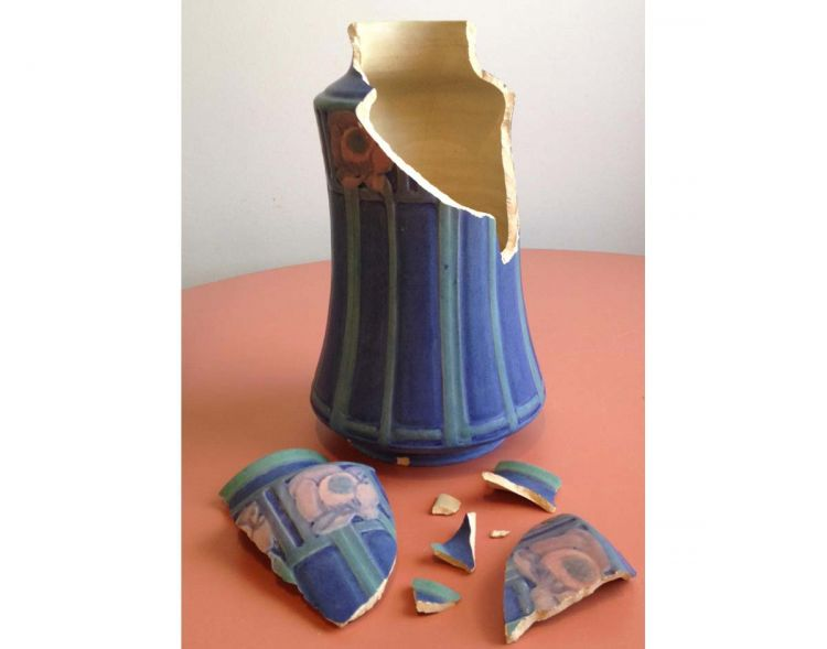 Broken Newcomb pottery